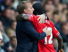 Victor Moses celebrates with the manager after scoring on his Liverpool debut.
