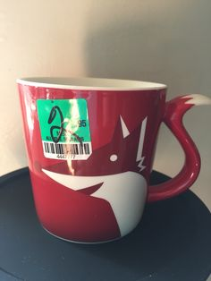 I thrifted this Starbucks 2012 red/white/ maroon fox tail handle mug.