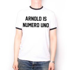 a265f7b0d60e6 As Worn By Arnold Schwarzenegger T Shirt - Arnold Is Numero Uno Cult 80 s  Action