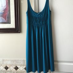 Ann Taylor LOFT shift XS Perfect for springtime!  Ann Taylor LOFT shift dress with ruche details on bodice in a gorgeous bright teal. Soft flattering easy care jersey material.   Size XS (4-6).    Smoke free  dog friendly.  Stored in clean household LOFT Dresses Midi