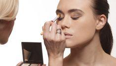 Beautician applying eye makeup