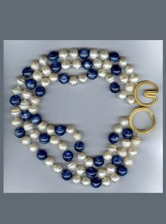 N-2761 Three strands of Kyanite and Freshwater Pearls with Ridged Angela clasp, 18K yellow Gold