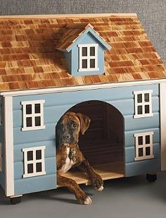 Protect your dog from the elements while providing a comfortable place to rest with the charming Nantucket Colonial Dog House, available in two colors.