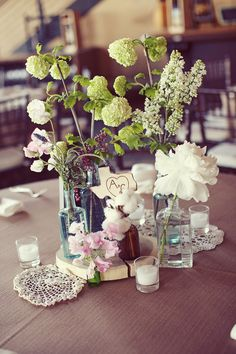 Wood round, mismatched glass (some vintage medicine bottles), and doilies.  I just adore this!