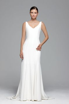 A beautiful silk crepe soft wedding dress with straps, a delicate fishtail silhouette and clean finish.