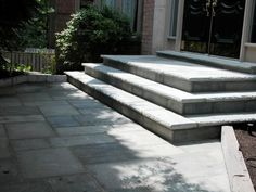 Square cut natural stone threshold, steps and walkway