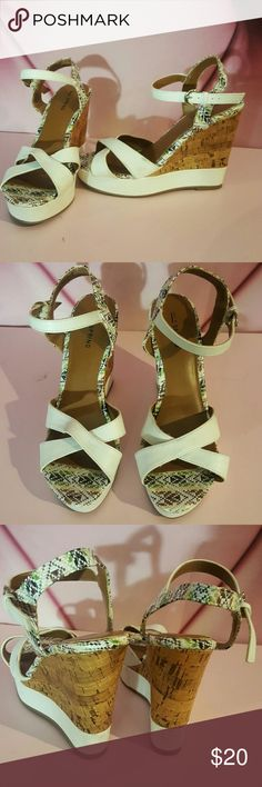 Call it Spring strappy cork wedge heels sandals Worn once to an event  A few minor marks that most likely can be removed but I haven't tried   Super cute wedge is about 5 inches with about a 1 inch platform in the front  Item sold as is so please ask any questions Call It Spring Shoes Platforms