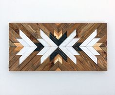 This piece is made to order. Lead time for shipping is 4 to 6 weeks. The photo shown is a previously sold beautiful modern art piece made with reclaimed wood. Its made with pallet and reclaimed wood It can be hanged vertically or horizontally. We used 2 different wood stains and painted a few pieces with white paint. This piece would add a modern look anywhere in your home! We can make this same piece with different sizes and colors as well, please contact us for more information! Sizes…