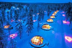 """Top 10 Ice Hotels - A surreal adventure to stay in an ice hotel and see the northern lights - for our next Valentines day trip perhaps? This photo shows a glass igloo for viewing the lights from your """"cozy"""" bed. Some places provide a wake up call when the lights are visible."""