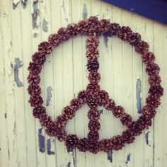 Fir cone peace - Would this work on the front of my house, similar to the metal stars people put on the front of their houses???