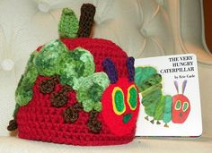 Ravelry: Caterpillar Ate an Apple Hat ( The Very Hungry Caterpillar Inspired) pattern by Yarn Artists Crochet Kids Hats, Cute Crochet, Crochet Crafts, Crochet Yarn, Yarn Crafts, Crochet Projects, Knitted Hats, Chrochet, Crochet Character Hats