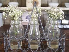 I have old milk bottles and trying to get some ideas to use them... i love the Babies Breath.