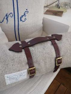 Bridle leather blanket straps... she makes yoga mat straps too . like the cross stich initials .