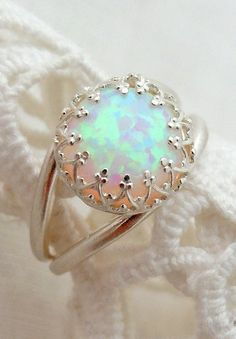 This looks eerily similar, especially the crown like setting,  to an opal ring that I had made for myself (from pieces that I handpicked, including the opal!) by a really kind jeweler when I was about eighteen years old and living in Saint Petersburg, FL, with my (now) ex-husband. Oh, memories... I wish I had never lost that pretty little ring!