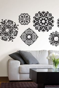 """Black and elegant, the baroque wall art kit offers a fabulous array of bold medallions with grand style, all of which are accented with mirror embellishments. $18.50  BUT, here is my idea...use some as ceiling medallions by cutting out the mirrors and putting them around your light fixture on your ceiling. WOW!  - Repositionable and always removable  - Comes on two 17.25"""" x 39"""" sheets and contains six total pieces  - Includes a pack of mirror accent"""