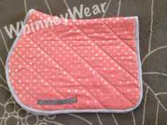 """NEW! 100% handmade by WhinneyWear. Coral/metallic silver polka dot AP pad with gray girth straps. Matching billet straps can be added for $5. Spine measures 23"""" with a 21"""" drop. Black flannel underside and lightly padded. Machine wash cold and air dry. $45 plus shipping. Purchase at www.whinneywear.com"""
