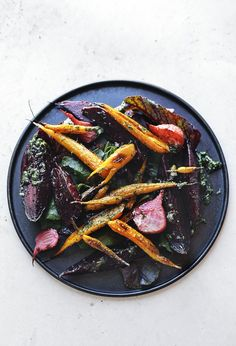 Roasted root vegetable salad with carrot top pesto.