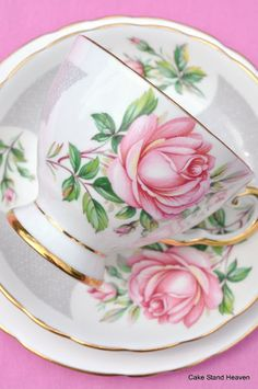 Pretty tea cup with pink rose