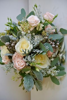 Winter brides bouquet, pink, ivory and silver. Bombastic spray Roses, Dusty miller.