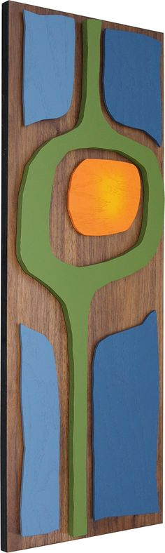 """Mid Century Modern Wall Art: NUCLEART - Painting, Hanging Sculpture - Abstract Wood Artwork. In the tradition of mid century decor, this piece shows vibrant colored shapes floating on a substantial and beautifully grained walnut plywood backing. Each piece was designed and hand built by Vincent D and is signed by the artist on the back. Atomic Pad art pieces are made-to-order. The piece comes with the necessary hardware attached and is ready to hang. Measurements: 36"""" x 12"""" x 2""""."""