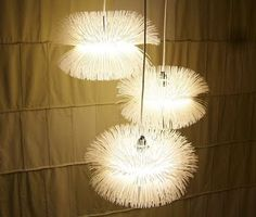Light fixtures made of zip ties! Saw a really cool one at Anthropologie the other day. Must make!