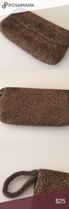 """Handmade in France Beaded Clutch Brand new condition, bought in France. All hand beaded. Beautiful Clutch. Snap closure, one pocket on the inside. Measures 8x5"""" Handmade Bags Clutches & Wristlets"""