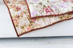 part of color patchwork quilt with vintage flowers pattern lying on a