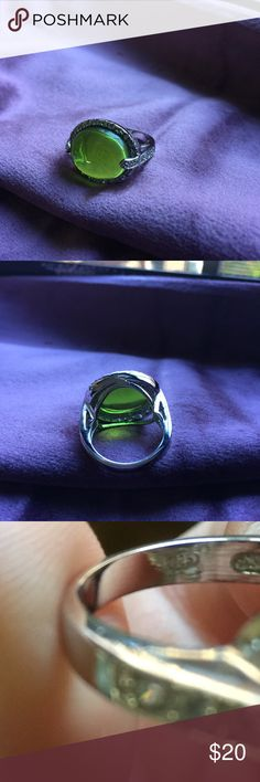 Glass Green Peridot Costume Silver Ring New without tags and never worn- green glass Peridot ring in a costume style - not real diamonds or silver- large size either a 9/10. Pretty color and very unique! Jewelry Rings