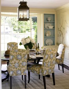blue paint in shelving plus colors on dining chairs