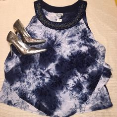 """2X dressy top with beading Navy and white top with navy flocked floral design. Front has intricate beading at the neck line and three tiered layers of sheer fabric forming a figure flattering v-shape at the front hem. Back is a single layer of sheer fabric. So easy to dress up but charming with jeans as well. Top of shoulder to hem is 26""""., slightly longer in the center front. 91% polyester  5% nylon  4% spandex. BRAND NEW with tags. No Trades. Dress Barn Tops"""
