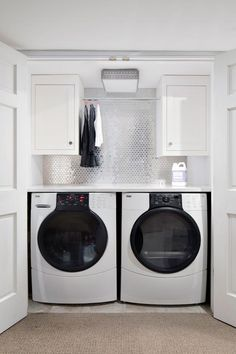 Take a peek at this small but organized laundry closet with a silver backsplash on HGTV.com.