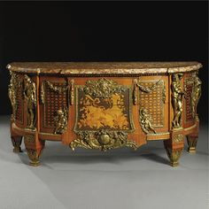 A LOUIS XVI STYLE GILT-BRONZE MOUNTED MARQUETRY AND PARQUETRY COMMODE<br>FRENCH, CIRCA 1900, AFTER THE MODEL BY JEAN-HENRI RIESENER | lot | Sotheby's