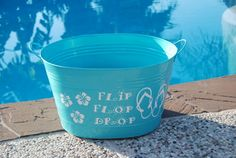 DIY Flip Flop Bucket for by the pool or back door. Tired of everyone's flip flops scattered around for someone to trip over? Make this bucket for everyone to drop their flops in.