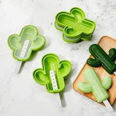 Shop Lékué Cactus Popsicle Molds, Set of Create a cold, refreshing treat inspired by the hot desert. Delightfully shaped like saguaro cacti, the four green molds can be filled with any of your favorite popsicle recipes. Healthy Popsicle Recipes, Healthy Popsicles, Crate And Barrel, Freeze Dried Fruit, Cactus Decor, Cactus Cactus, Cactus Food, Popsicle Molds, Snack Bowls