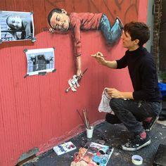 """Ernest Zacharevic @ernestzacharevic working on the third piece in our #replaynyc series. #streetart #elbarrio"""