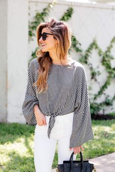 Tie front gingham blouse with white jeans and red earrings, gingham outfit, bell sleeve outfit