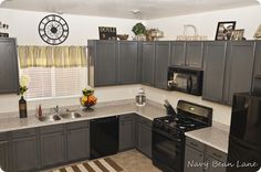 LOVE; they did gray paint in Olympic Nights Arbor, with black glaze on top - LOVE!  Plus, I like it with the blank appliances, which I haven't see (we have black appliances), & it looks good