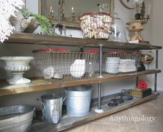 Anythingology: DIY Industrial Shelves She bought new lumber and distressed it with vinegar and steel wool.  Then she combined it with steel plumbing pipes and added some wheels so it's portable. Fascinating how she mixed up the industrial items with ornate, traditional items in this room.