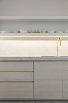 love the cabinets. this is what I want, the strip between each drawer. as well as the marble and wood combo