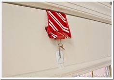 How to hang a Wreath over your door without any damage or an average wreath hanger.