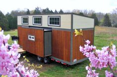 This is a tiny house on wheels with slide outs designed with baby boomers in mind by Tiny By Design. From the outside, you'll notice it has a shed-style roof to maximize spaciousness when you…