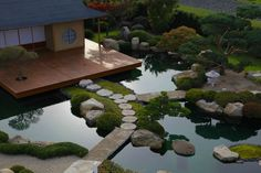 - interesting also...steps surrounded by small patch of grass but still surrounded by pond. - plants/trees/accents; - positioning of tree (left of pic) on the platform of the tea house is also something to consider