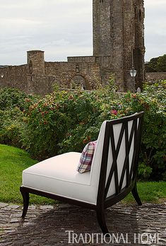 "Furniture in St. Andrews:  Baker's ""Castel"" chair by Jacques Garcia is graphically striking in ivory ""Stornoway"" tweed from Johnstons of Elgin.  The pillow is made from The Isle Mill's ""Shiel Magenta"" wool.  Photo: Dominic Blackmore 