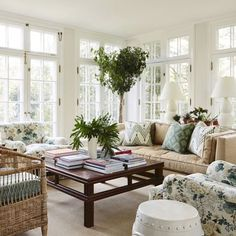 Beautiful white and natural #sunroom with pops of gorgeous green shades! Design by @mcgrath2 #homedecor #interiordesign