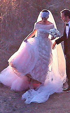 Anne Hathaway & Adam Shulman, married on September 29th, 2012 in Big Sur, CA. Her gown was a custom Valentino.