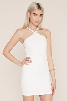 A knit bodycon dress with dual cami straps and a concealed side zipper.