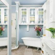By angling the tub and shower entry in the two far corners, Susan made room for both fixtures on one end of the room. She tucked the toilet out of sight in a niche created by a bumpout for the master bedroom's walk-in closet. And to leave ample counter space for toiletries, she designed a double-wide vanity for just a single sink.