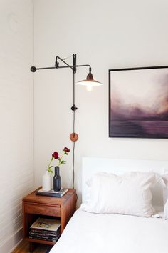 Industrial floor lamp above bedside