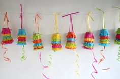 Make this: Pull PiñataGarland- out of tp rolls.  Super cute for Cinco de Mayo or a fiesta-themed party or use halved paper towel rolls.