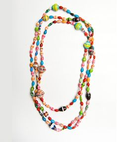Noonday Collection - The piece that will brighten your day no matter what. Made of festive handcrafted paper beads, you will light up a room whenever you wear this chunky necklace. This piece can be doubled or tripled depending on the look you want.
